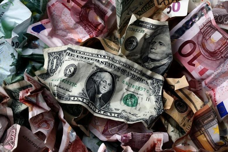 A picture illustration of crumpled kuna, Dollar and euro banknotes, taken in Zagreb January 18, 2011. REUTERS/Nikola Solic