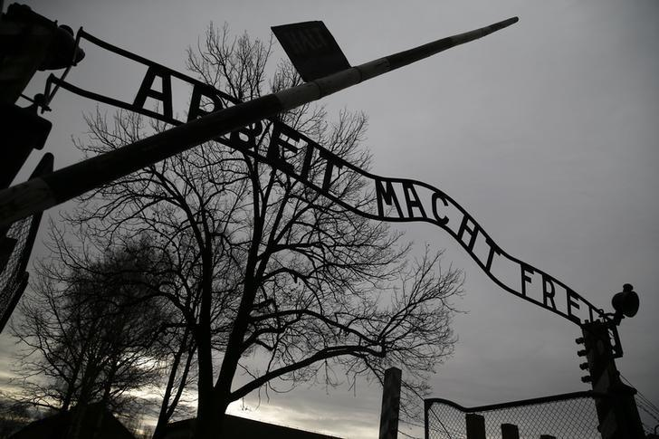 The Nazi slogan ''Arbeit macht frei'' (Work sets you free) is pictured at the gates of the former Nazi German concentration and extermination camp Auschwitz-Birkenau in Oswiecim, Poland January 27, 2016, during ceremonies to mark the 71th anniversary of the liberation of the camp by Soviet troops and to remember the victims of the Holocaust.  REUTERS/Kacper Pempel/File Photo