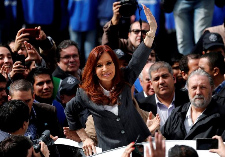 Former Argentine President Cristina Fernandez de Kirchner waves to supporters as she leaves a Justice building in Buenos Aires, Argentina, April 13, 2016. REUTERS/Marcos Brindicci/Files