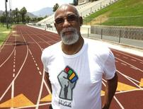 John Carlos, participant of the 1968 Olympics, stands on the campus track at Palm Springs High School, where he is a teacher and counsellor in Palm Springs, California July 11, 2012. Picture taken July 11, 2012. REUTERS/Alex Gallardo