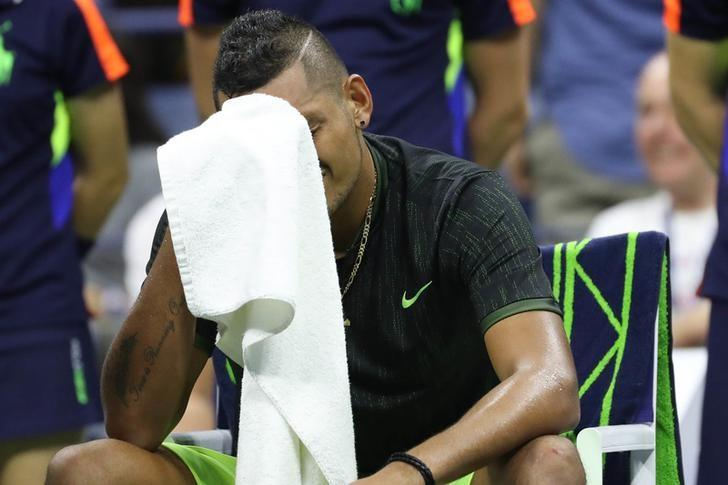 Sep 3, 2016; New York, NY, USA; Nick Kyrgios of Australia reacts during a changeover while battling with an injury in the third set against Ilya Marchenko of Ukraine (not pictured) on day six of the 2016 U.S. Open tennis tournament at USTA Billie Jean King National Tennis Center. Kyrgios would retire from the match, and Marchenko won 6-4, 4-6, 6-1, ret. Mandatory Credit: Geoff Burke-USA TODAY Sports