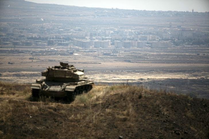 The Syrian area of Quneitra is seen in the background as an out-of-commission Israeli tank parks on a hill, near the ceasefire line between Israel and Syria, in the Israeli-occupied Golan Heights, August 21, 2015. REUTERS/Baz Ratner/File Photo