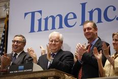 Time Inc. CEO Joe Ripp (2nd L) claps after ringing the bell to open trading at the New York Stock Exchange in New York June 9, 2014.  REUTERS/Carlo Allegri