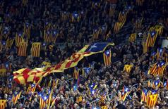 "People raise ""Estelada"" flags (Catalan separatist flag) before Champions League group E soccer match between Barcelona and Bate Borisov at Camp Nou stadium in Barcelona, Spain, November 4, 2015. REUTERS/Albert Gea"