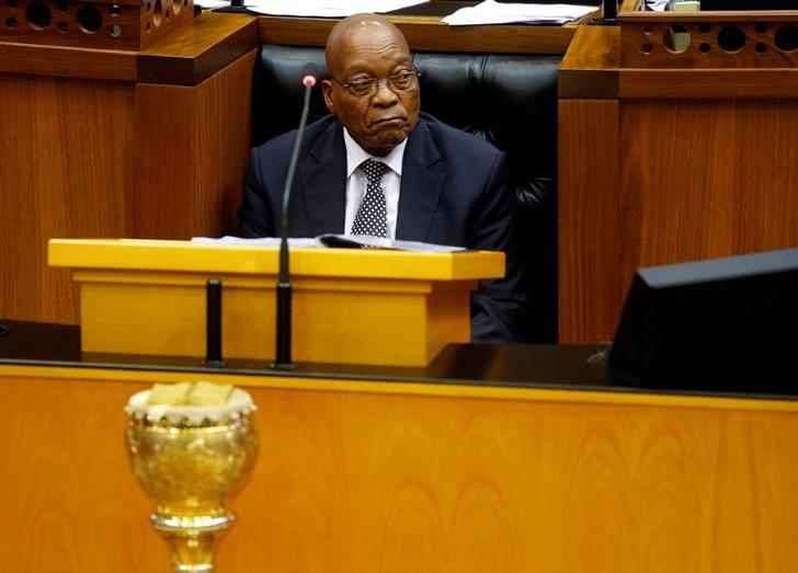 President Jacob Zuma looks on as members of Julius Malema's Economic Freedom Fighters (EFF) party raise objections during Zuma's question and answer session in Parliament in Cape Town, South Africa, September 13, 2016. REUTERS/Mike Hutchings