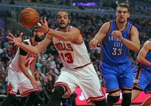 Mar 5, 2015; Chicago, IL, USA; Chicago Bulls center Joakim Noah (13) grabs a rebound past Oklahoma City Thunder forward Mitch McGary (33) during the second quarter at the United Center. Mandatory Credit: Dennis Wierzbicki-USA TODAY Sports