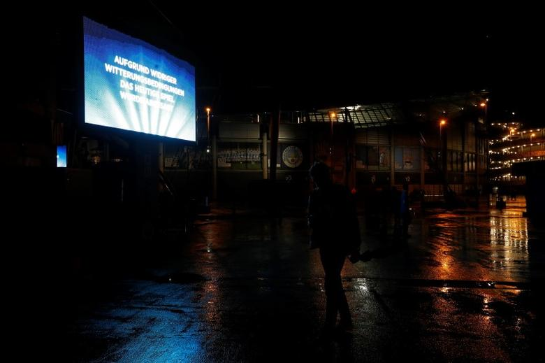 General view of the big screen outside the stadium announcing that the match has been postponed. Reuters / Darren Staples