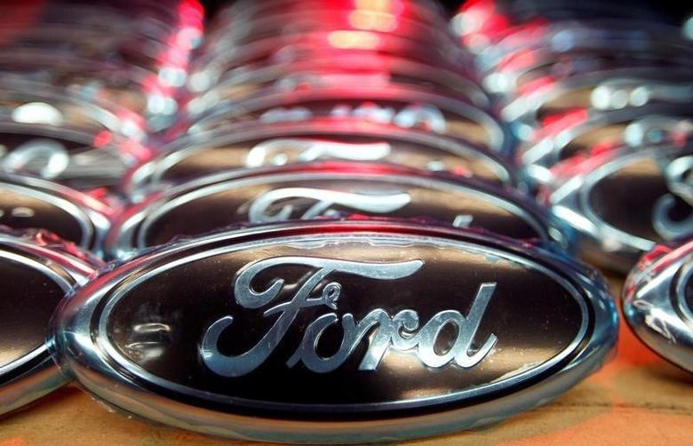 Ford logos are seen at the assembly line of the Ford car factory of Saarlouis, December 6, 2010.  REUTERS/Vincent Kessler/Files