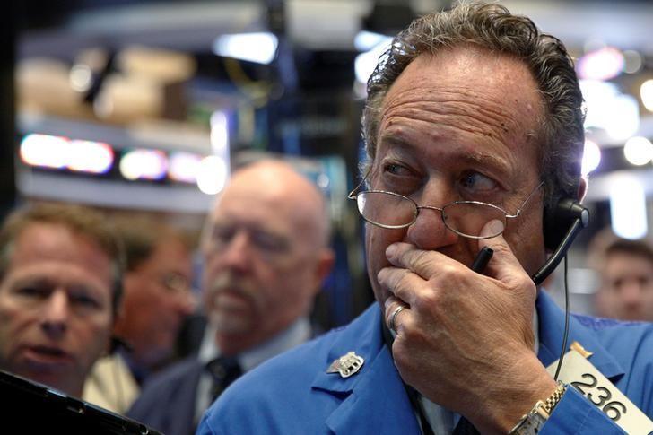 Traders work on the floor of the New York Stock Exchange (NYSE) in New York City, U.S., September 13, 2016.  REUTERS/Brendan McDermid