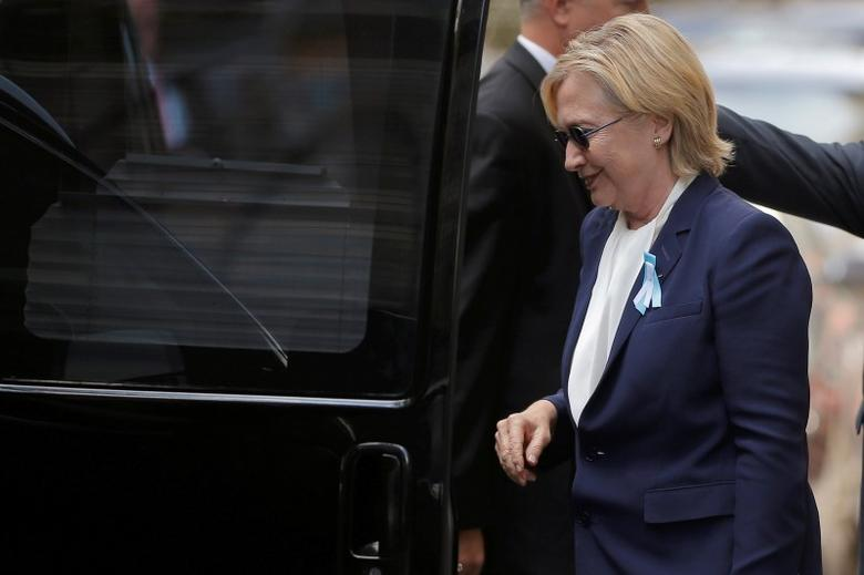 U.S. Democratic presidential candidate Hillary Clinton climbs into her van outside her daughter Chelsea's home in New York, New York, United States September 11, 2016, after Clinton left ceremonies commemorating the 15th anniversary of the September 11 attacks feeling ''overheated.''  REUTERS/Brian Snyder