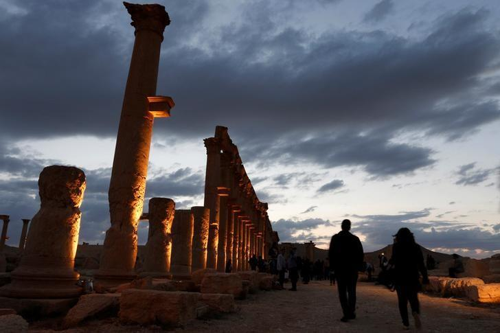 People visit the ruins of the historic city of Palmyra ahead of a musical event at its amphitheatre, Syria May 6, 2016. REUTERS/Omar Sanadiki/File Photo