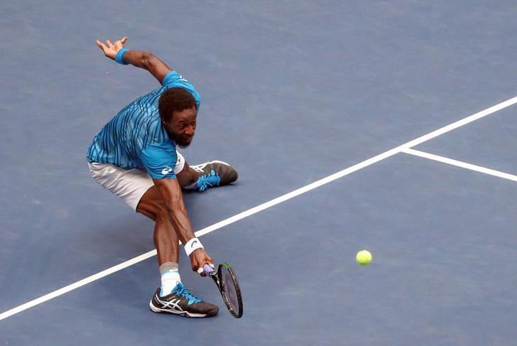 Sep 9, 2016; New York, NY, USA; Gael Monfils of France returns a shot to Novak Djokovic of Serbia on day twelve of the 2016 U.S. Open tennis tournament at USTA Billie Jean King National Tennis Center. Mandatory Credit: Anthony Gruppuso-USA TODAY Sports