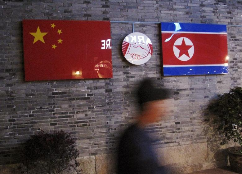 Flags of China and North Korea are seen outside the closed Ryugyong Korean Restaurant in Ningbo, Zhejiang province, China, April 12, 2016. REUTERS/Joseph Campbell