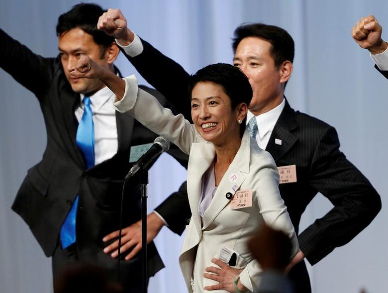 Japan's main opposition Democratic Party's new leader Renho (C) raises her fists with her party lawmakers after she was elected party leader at the party plenary meeting in Tokyo, Japan September 15, 2016.   REUTERS/Toru Hanai