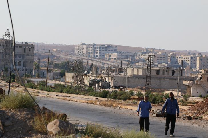 People walk near Castello road (background) in Aleppo, Syria, September 14, 2016. REUTERS/Abdalrhman Ismail