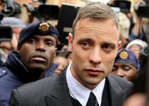 Olympic and Paralympic track star Oscar Pistorius leaves court after appearing for the 2013 killing of his girlfriend Reeva Steenkamp in the North Gauteng High Court in Pretoria, South Africa, June 14, 2016. REUTERS/Siphiwe Sibeko/Files
