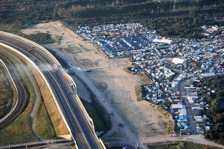 An aerial view shows makeshift shelters and tents where migrants live in what is known as the ''Jungle'', along the Rocade road, an approach road to the French port of Calais, France, September 7, 2016.  Picture taken September 7, 2016.  REUTERS/Charles Platiau