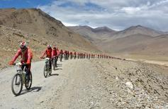 Buddhist nuns from the Drukpa lineage pictured in Ladakh during their cycle across the Himalayas to raise awareness about human trafficking of girls and women in the impoverished villages in Nepal and India August 30, 2016. REUTERS/Live To Love International/Handout via REUTERS