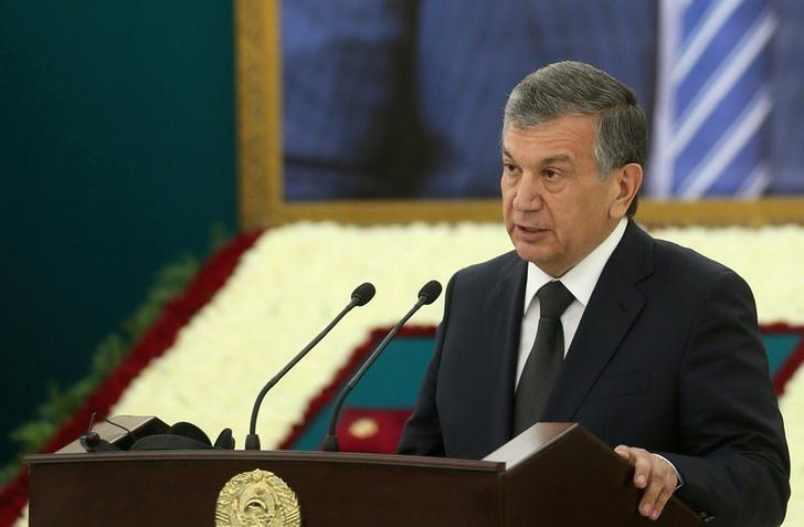 Uzbek Prime Minister Shavkat Mirziyoyev delivers a speech near a portrait of late President Islam Karimov during a mourning ceremony in Samarkand, Uzbekistan, September 3, 2016. Georgy Kakulia/Press Service of Georgian Government/Handout via Reuters/File Photo