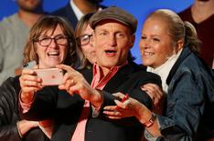 Actor Woody Harrelson greets fans as he arrives on the red carpet for the film LBJ. REUTERS/Mark Blinch