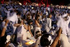 People attend Diner En Blanc, the French-inspired secret pop-up dinner, in Robert F. Wagner Jr. Park, in New York. REUTERS/Alex Wroblewski
