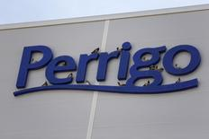 Birds are seen on the logo of generic drugmaker Perrigo Co outside their new factory in the city of Yeruham, in southern Israel March 2, 2016. REUTERS/Amir Cohen