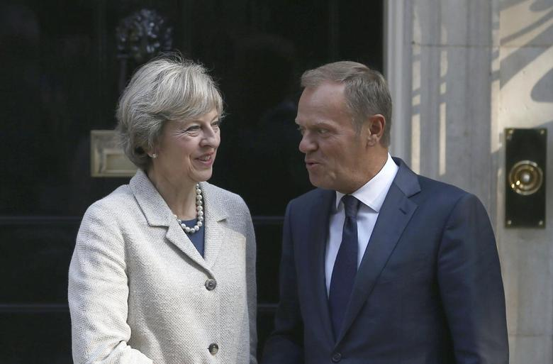 Britain's Prime Minister Theresa May (L) greets European Council President Donald Tusk in Downing Street in London, Britain September 8, 2016. REUTERS/Neil Hall