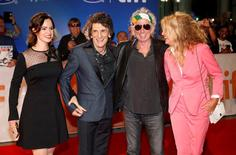 "Keith Richards (2nd R) arrives with his wife Patti Hansen and fellow bandmate Ronnie Wood (L) and his wife Sally Humphreys on the red carpet for the film ""The Rolling Stones Ole Ole Ole! : A Trip Across Latin America"" during the 41st Toronto International Film Festival (TIFF), in Toronto, Canada, September 16, 2016.    REUTERS/Mark Blinch"