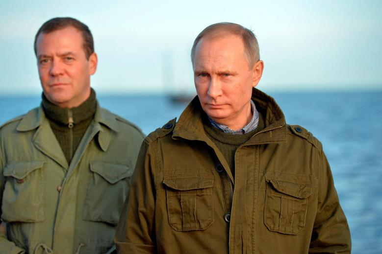 Russian President Vladimir Putin (R) and Prime Minister Dmitry Medvedev are seen during their tour on Lake Ilmen in Novgorod region, Russia, September 10, 2016. Sputnik/Kremlin/Alexei Druzhinin/via REUTERS