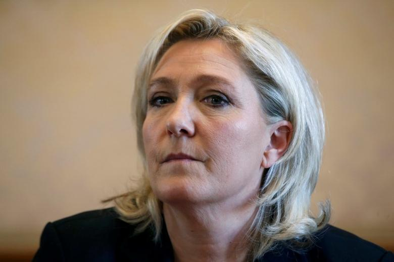 France's far-right National Front political party leader Marine Le Pen attends a news conference at the National Assembly in Paris, France, April 7, 2016. REUTERS/Philippe Wojazer/File Photo