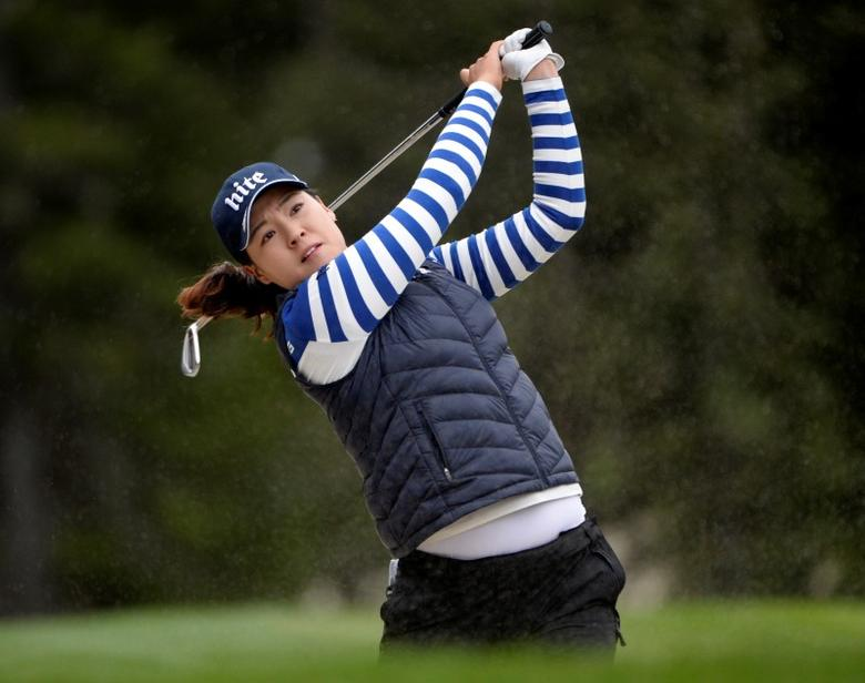 Aug 28, 2016; Calgary, Alberta, CAN;  In Gee Chun of South Korea hits her second shot on the 1st hole during the final round of the Canadian Pacific Women's Open at Priddis Greens Golf and Country Club. Mandatory Credit: Eric Bolte-USA TODAY Sports