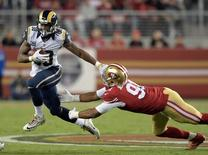 Sep 12, 2016; Santa Clara, CA, USA; Los Angeles Rams running back Todd Gurley (30) is defended by San Francisco 49ers defensive end Arik Armstead (91) during a NFL game at Levi's Stadium. Mandatory Credit: Kirby Lee-USA TODAY Sports