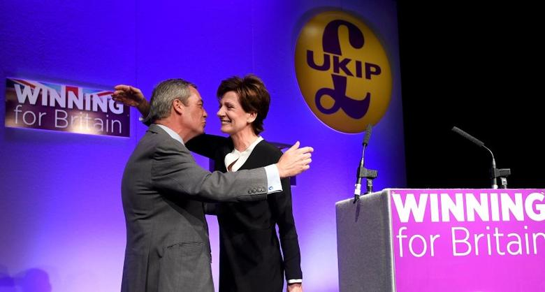 Nigel Farage (L), the outgoing leader of the United Kingdom Independence Party (UKIP), congratulates new leader Diane James, at the party's annual conference in Bournemouth, Britain, September 16, 2016. REUTERS/Toby Melville