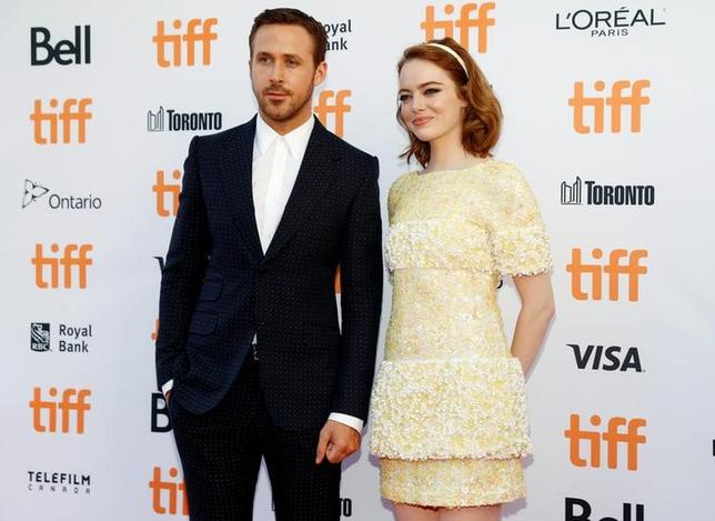 Actor Ryan Gosling arrives with Emma Stone on the red carpet for the film ''La La Land'' during the 41st Toronto International Film Festival (TIFF), in Toronto, Canada, September 12, 2016.    REUTERS/Mark Blinch
