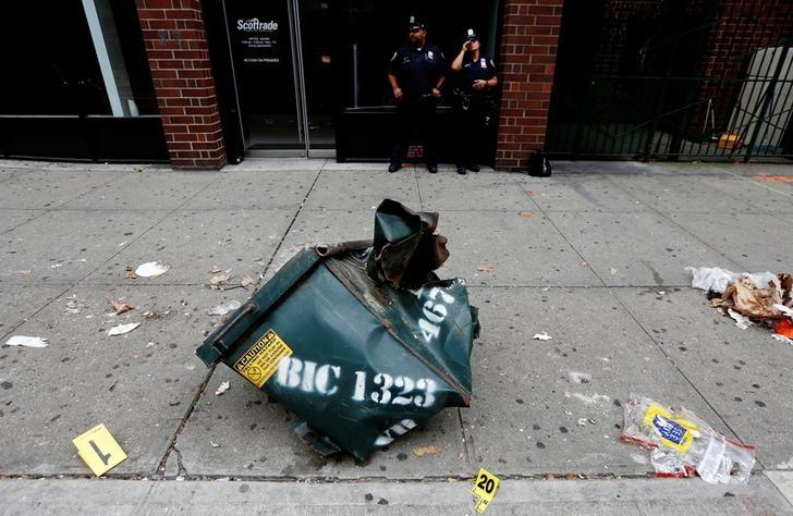 A view of a mangled dumpster at the site of an explosion that occurred on Saturday night in the Chelsea neighborhood of New York, USA,  September 18, 2016.   REUTERS/Justin Lane/Pool