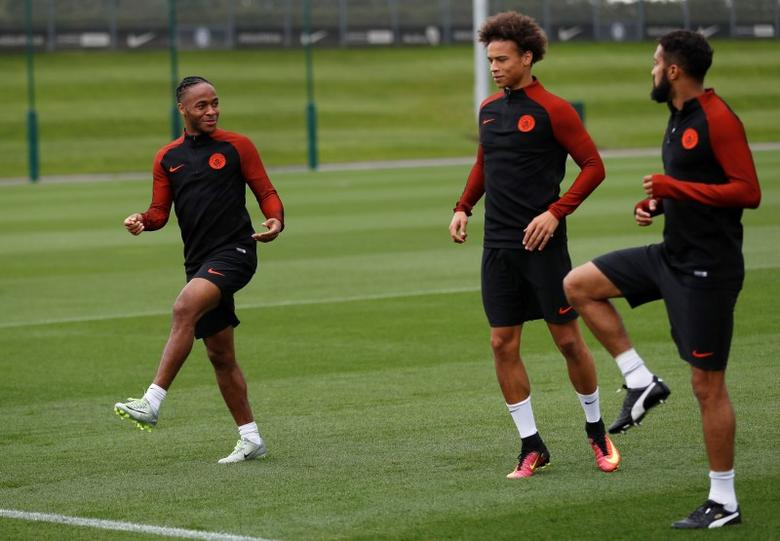 Britain Football Soccer - Manchester City Training - City Football Academy - 12/9/16Manchester City's Raheem Sterling and Leroy Sane during trainingAction Images via Reuters / Carl RecineLivepic