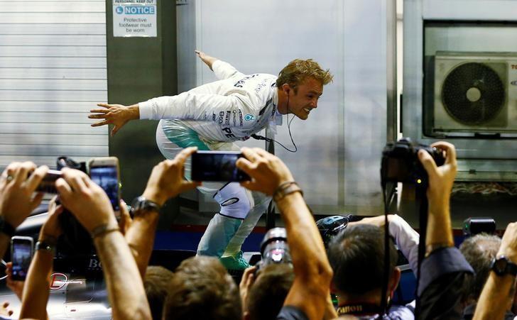 Formula One - F1 - Singapore Grand Prix - Marina Bay, Singapore- 18/9/16 Mercedes' Nico Rosberg of Germany celebrates winning the race. REUTERS/Jeremy Lee