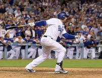 Sep 19, 2016; Los Angeles, CA, USA; Los Angeles Dodgers first baseman Adrian Gonzalez (23) follows through on a walk-off double in the ninth inning in a 2-1 victory over the San Francisco Giants during a MLB game at Dodger Stadium. Mandatory Credit: Kirby Lee-USA TODAY Sports
