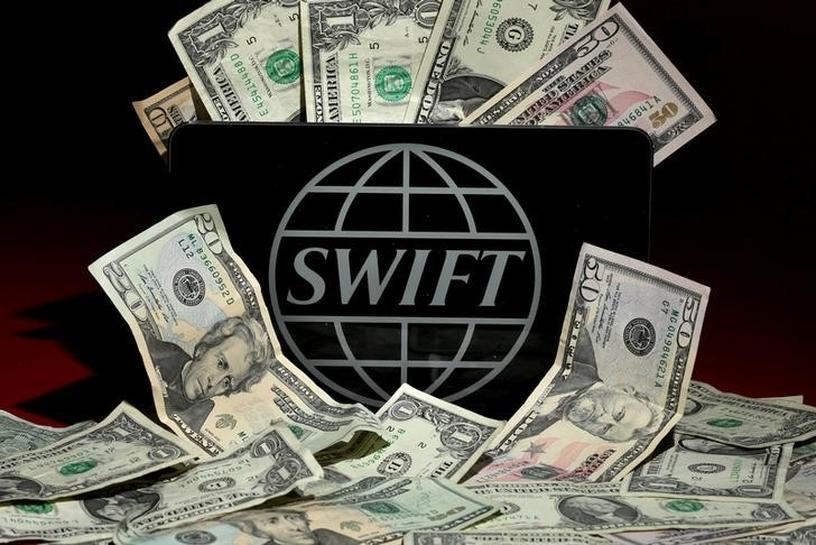 SWIFT plans measure to help spot fraudulent bank transfers | Reuters