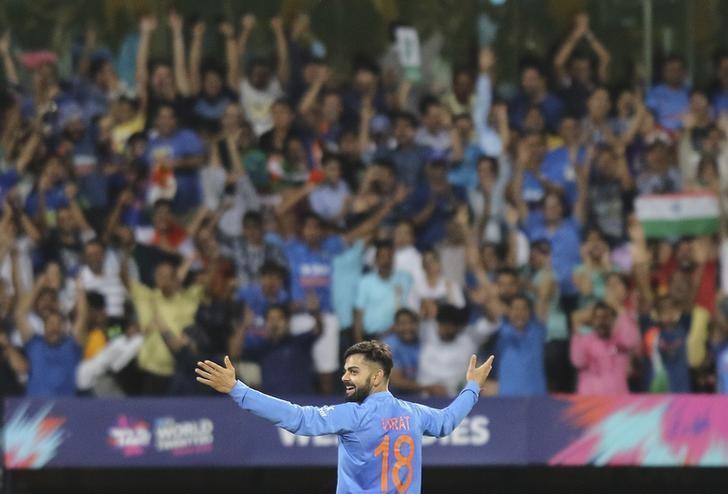 Cricket - West Indies v India - World Twenty20 cricket tournament semi-final - Mumbai, India - 31/03/2016. India's Virat Kohli celebrates taking the wicket of West Indies Johnson Charles. REUTERS/Shailesh Andrade/Files