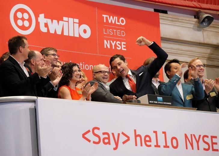 Jeff Lawson, (C) Founder, CEO, & Chairman of Communications software provider Twilio Inc., rings the opening bell to celebrate his company's IPO at the New York Stock Exchange (NYSE) in New York City, U.S., June 23, 2016. REUTERS/Brendan McDermid/Files