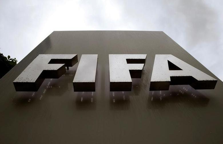 Raindrops flow down on a logo in front of FIFA's headquarters in Zurich, Switzerland June 8, 2016. REUTERS/Arnd Wiegmann
