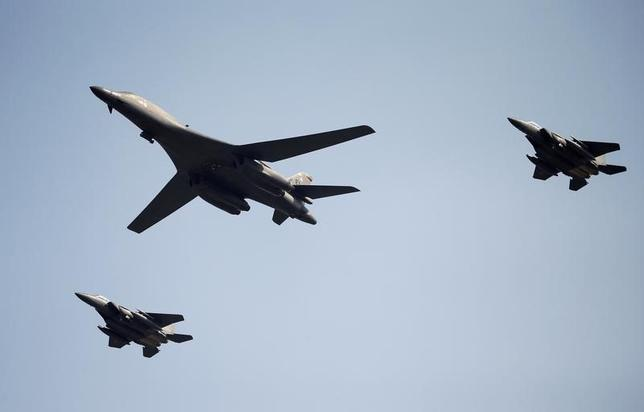 A U.S. Air Force B-1B bomber flies over Osan Air Base in Pyeongtaek, South Korea, September 13, 2016.  REUTERS/Kim Hong-Ji/Files