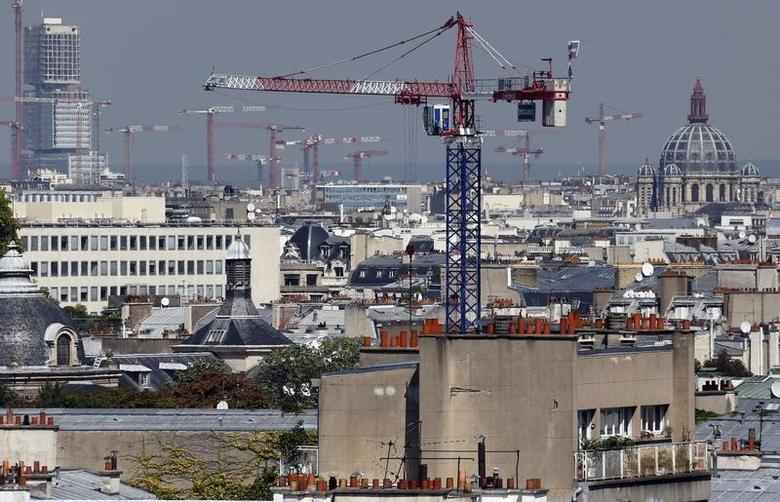 Construction cranes are seen on building sites which fill the horizon in Paris, France, August 26, 2016. REUTERS/Regis Duvignau