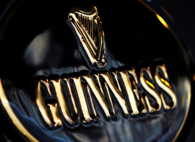 Diageo's Guinness branding is seen outside a pub in London February 12, 2008.  REUTERS/Stephen Hird/File Photo