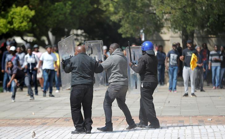 Students throw stones during clashes with security at Johannesburg's University of the Witwatersrand as countrywide protests demanding free tertiary education entered a third week, South Africa, September 20, 2016. REUTERS/Siphiwe Sibeko