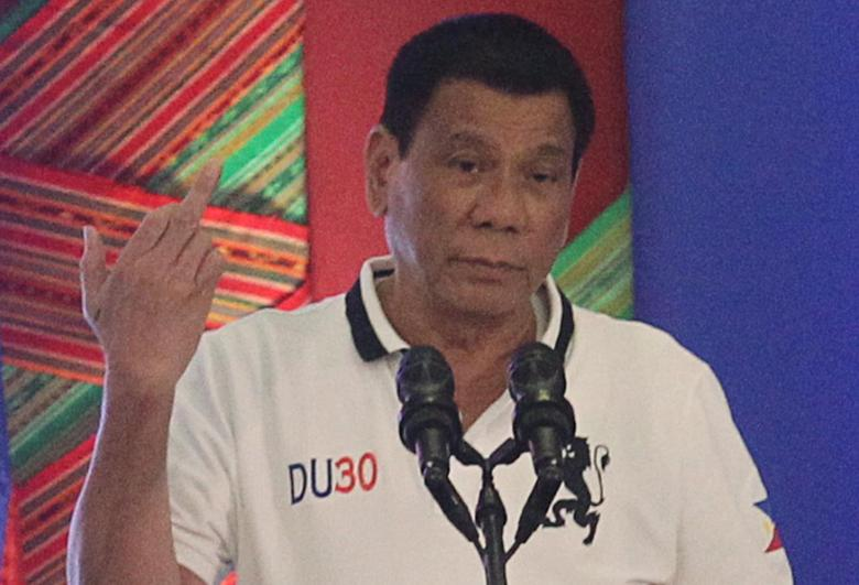 Philippine President Rodrigo Duterte raises a middle finger thrust out in an obscene gesture as he speaks before local government officials in Davao city, in southern Philippines, September 20, 2016. Picture taken September 20, 2016.  REUTERS/Lean Daval Jr