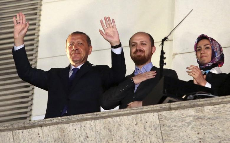 Turkish Prime Minister Tayyip Erdogan (L), accompanied by his son Bilal and daughter Sumeyye, greets his supporters at the AK Party headquarters in Ankara March 30, 2014. REUTERS/Stringer