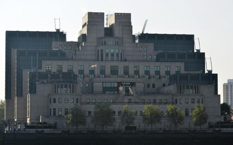 The MI6 Vauxhall Cross building raises the Rainbow Flag to mark its support for the International Day Against Homophobia, Transphobia and Biphobia in London, Britain, May 17, 2016. REUTERS/Hannah McKay