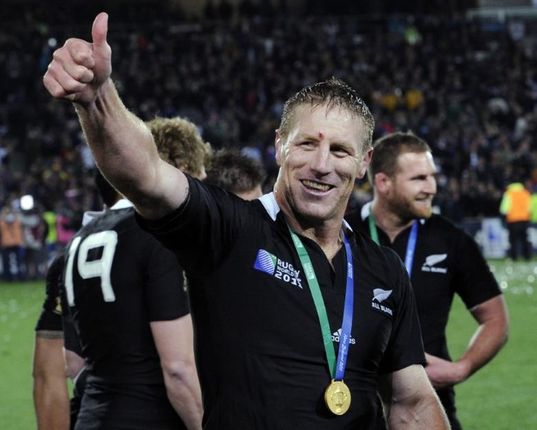 File photograph of New Zealand All Blacks' Brad Thorn giving a thumbs up after receiving his gold medal, beating France to win the Rugby World Cup final at Eden Park in Auckland October 23, 2011.  REUTERS/Anthony Phelps